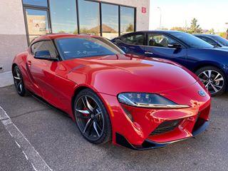 Window tint on 2020 red Toyota Supra.