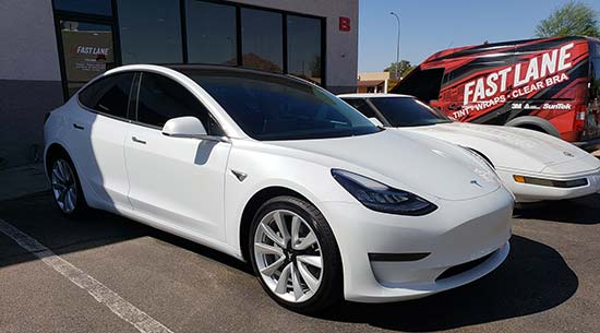 Tesla, Corvette, and Fast Lane Window Tinting van in front of our Scottsdale shop