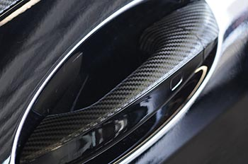 Mercedes door handle wrapped in carbon fiber