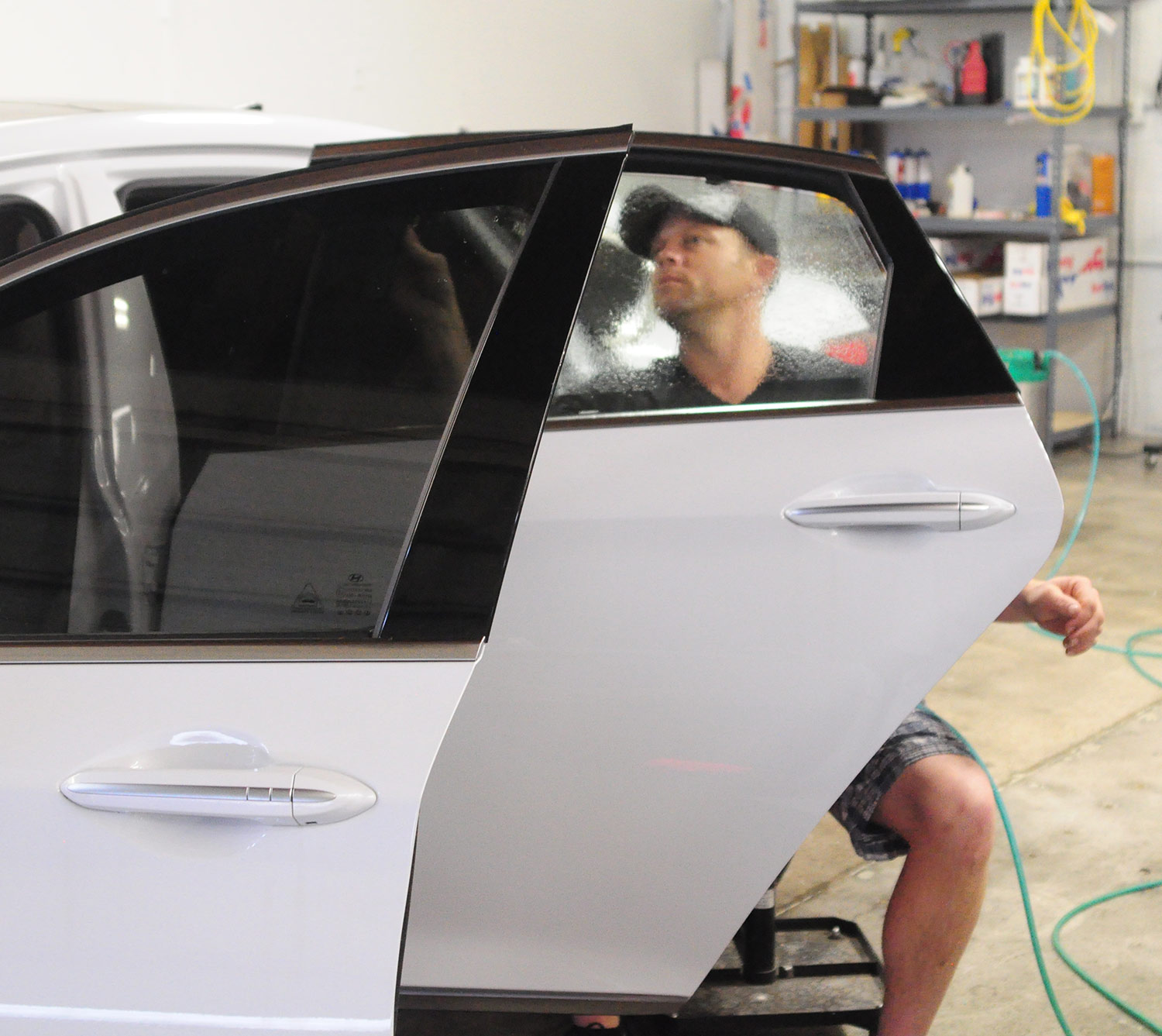 Installing ceramic window tint on a Genesis coupe.