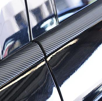 Black Mercedes with black carbon fiber over trim.