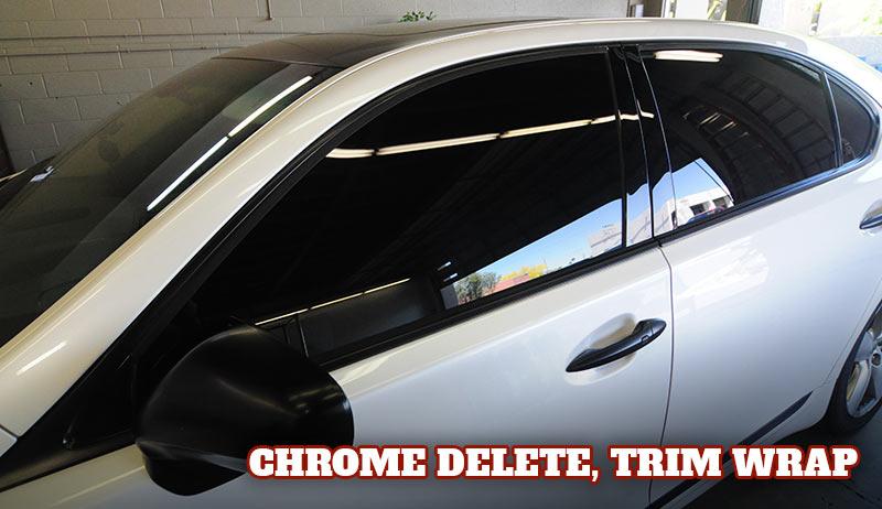 White Lexus sedan with black wrapped trim and door handles, gloss black vinyl.