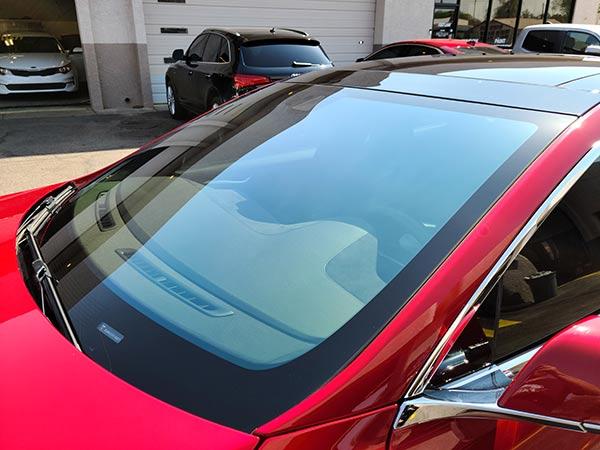 70% CIR windshield tint on red Tesla
