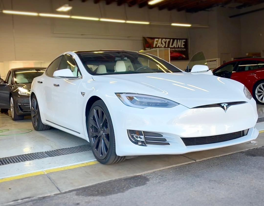 White Tesla in the shop