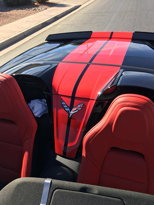 Corvette with leather interior and custom vinyl stripes.