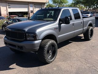 Wrapped Ford F250 in silver/charcoal vinyl.