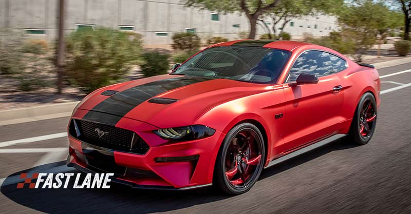 Red matte chrome wrapped Ford Mustang.
