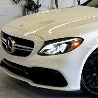 White Mercedes getting Scottsdale Paint Protection Film