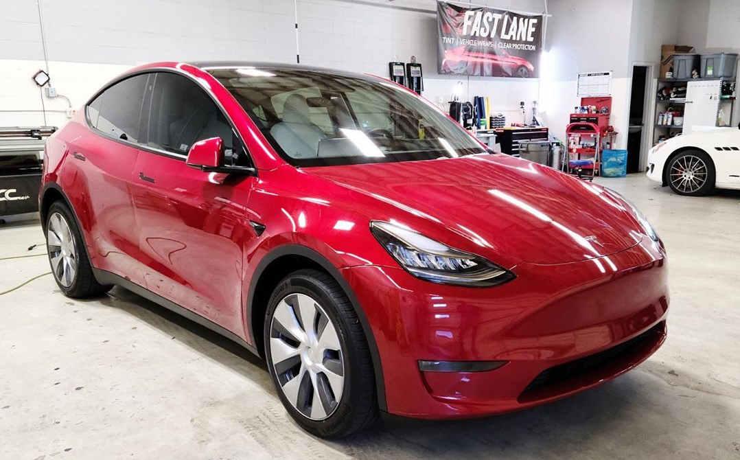 Red Tesla Model Y at Fast Lane.