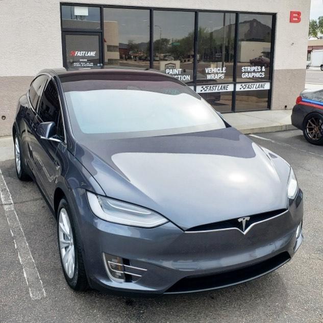 Model X in front of Fast Lane on Scottsdale Road