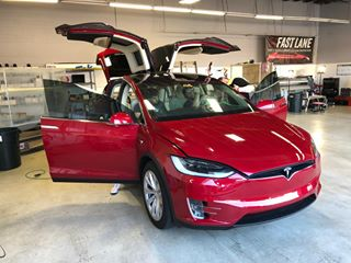 Red Tesla in process of tinting.