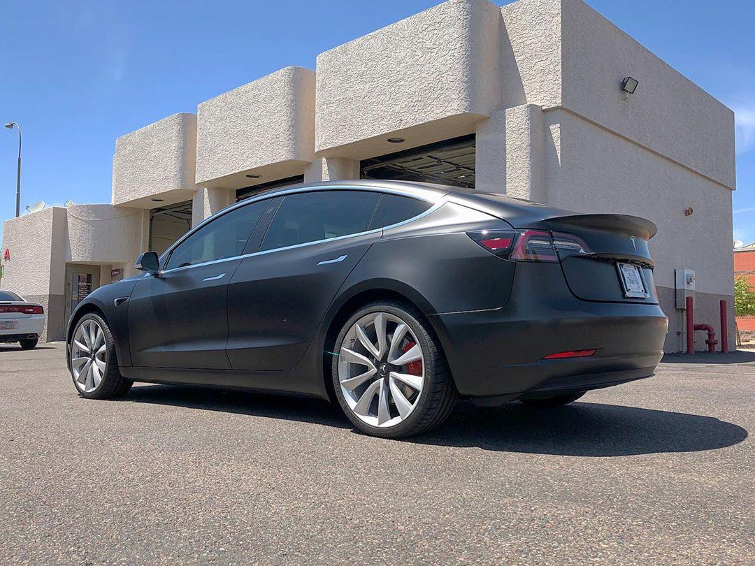 Tesla vehicle wrap in satin black.