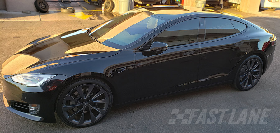 Matte charcoal wrapped Tesla with vinyl trim wrap / chrome delete.