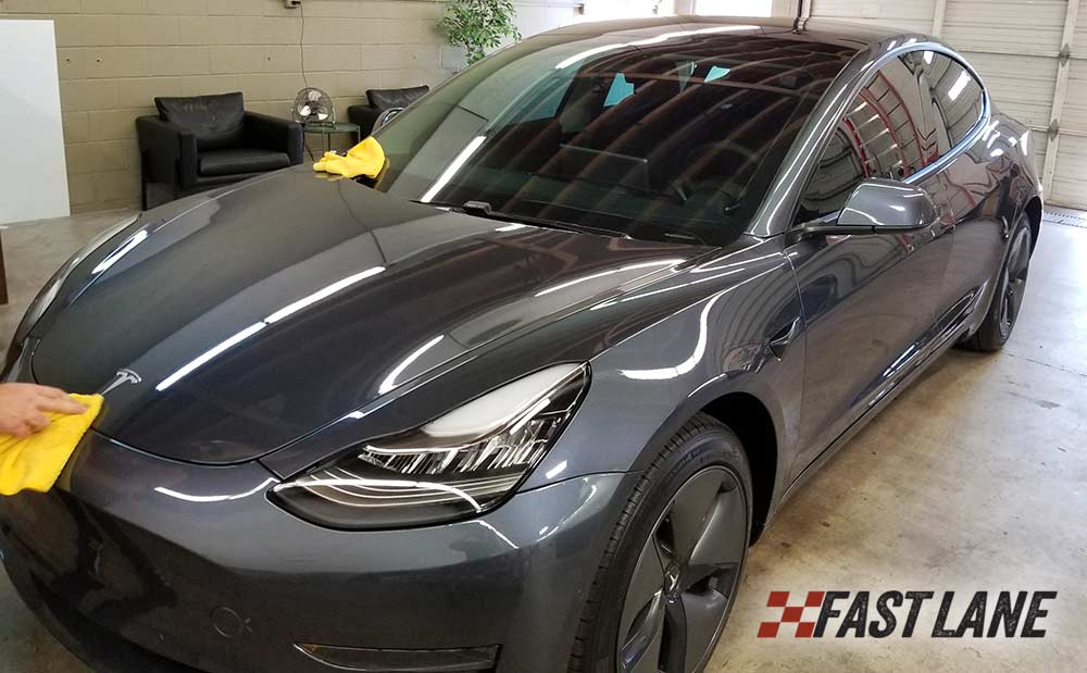 Full front clip paint protection film on a Tesla Model 3.