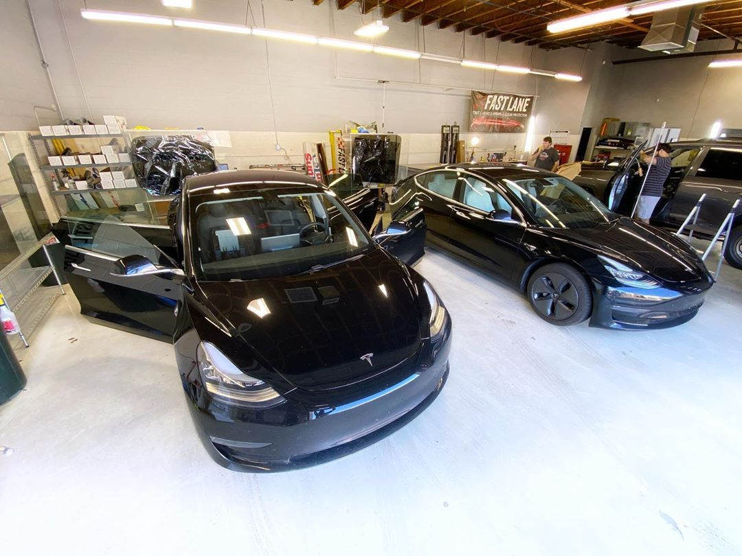 Black model 3 teslas at Fast Lane