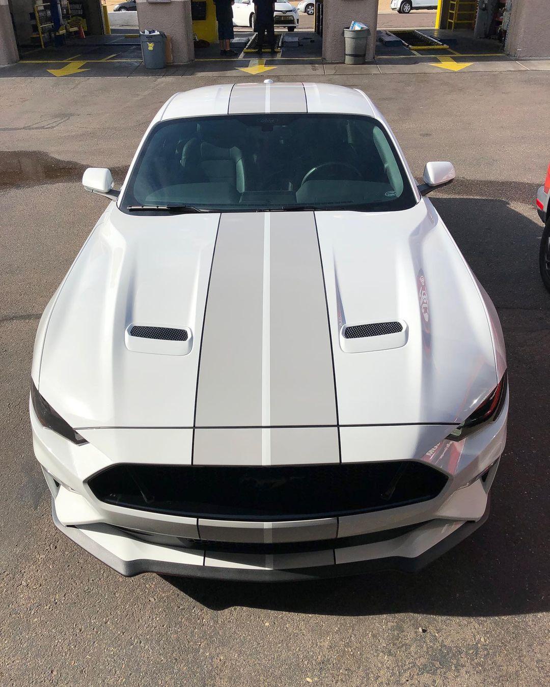 Custom gray stripes on a white Mustang.