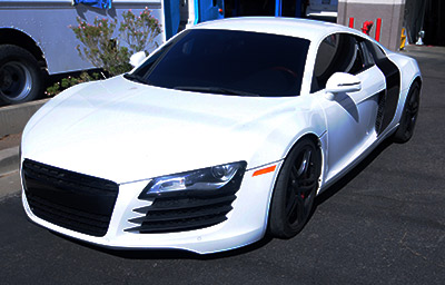 Audi R8 with fresh premium window tint and vinyl wrap on the panels.
