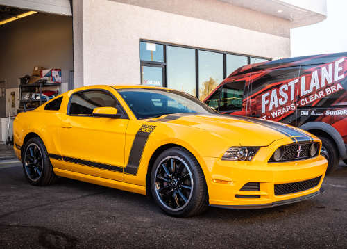 Yellow Mustang with window tinting.