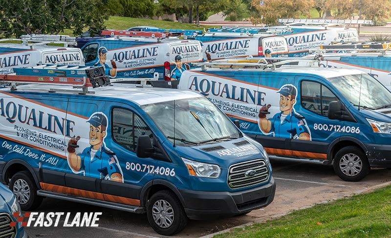 Marketing in motion: fleet of work trucks with vehicle graphics by FastLane.