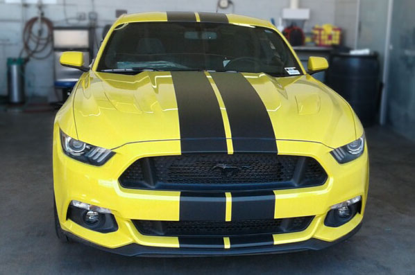 Yellow Ford Mustang with black vinyl stripes in Scottsdale AZ